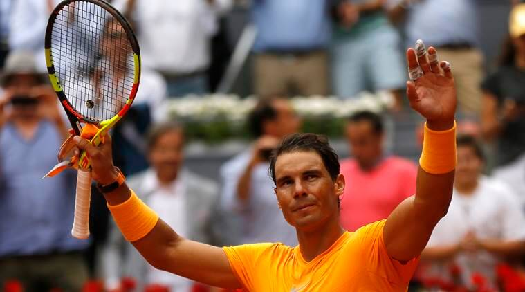 Rafa Nadal thanks the crowd after the win over Gael Monfils at the Madrid Open