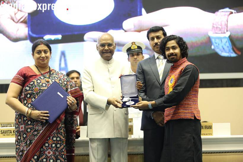Bengali actor Riddhi Sen accepts his Best Actor (Male) award for his film Nagakirtan from President Ram Nath Kovind. (Express Photo: Tashi Tobgyal)
