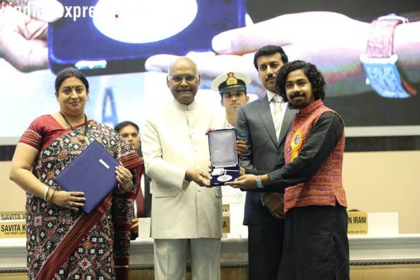 Bengali actor Riddhi Sen accepts his Best Actor (Male) award for his film Nagakirtan from President Ram Nath Kovind. (Express Photo: Tashi Tobgyal)