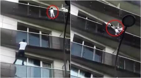 Paris 'Spiderman' hailed hero after climbing four floors in seconds to save child