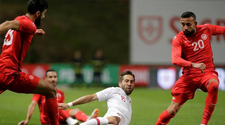 Portugal's Joao Moutinho in action with Tunisia's Ghailan Chaalali