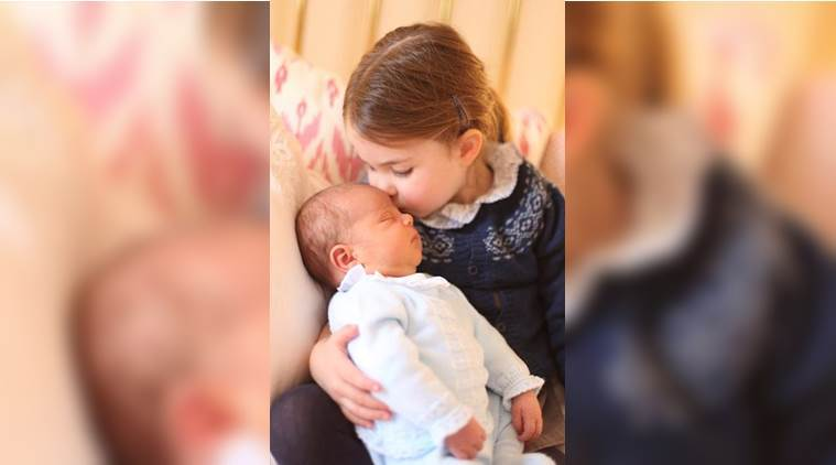 One of the photo shows Prince Louis being cuddled by three-year-old big sister Princess Charlotte. (Reuters)