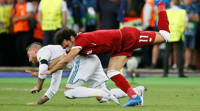 Liverpool's Mohamed Salah injures his shoulder in a challenge with Real Madrid's Sergio Ramos