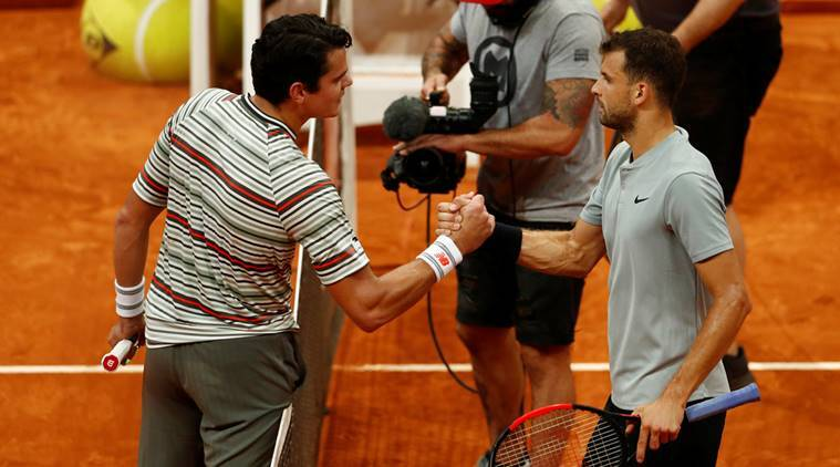 Grigor Dimitrov and Milos Raonic at the net in Madrid Open