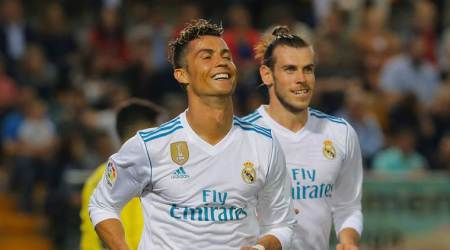 Real Madrid's Cristiano Ronaldo celebrates scoring their second goal with Gareth Bale