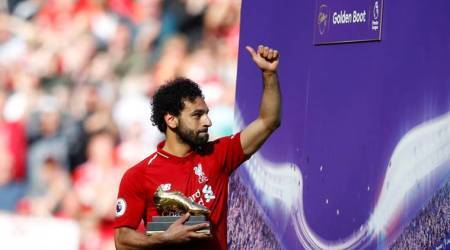 Liverpool's Mohamed Salah celebrates with the Golden Boot after the match against Brighton