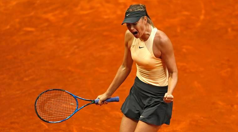 Maria Sharapova from Russia celebrates a winning point during her Madrid Open tennis tournament match with Kristina Mladenovic from France, in Madrid, Spain