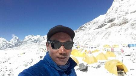 Nepali Sherpa summits Mount Everest for record 22nd time