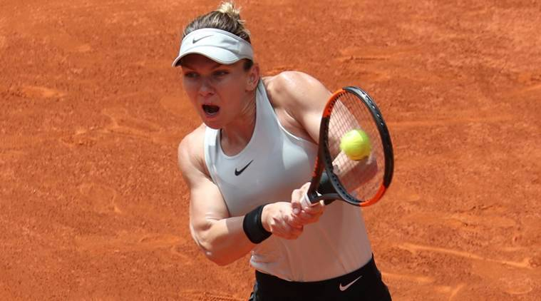 Jittery Halep makes labored start at French Open