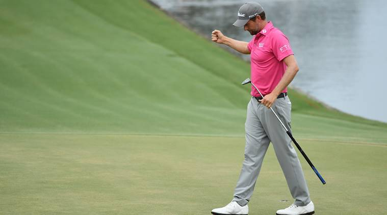 Webb Simpson celebrates on the 18th green after winning the final round of The Players Championship golf tournament