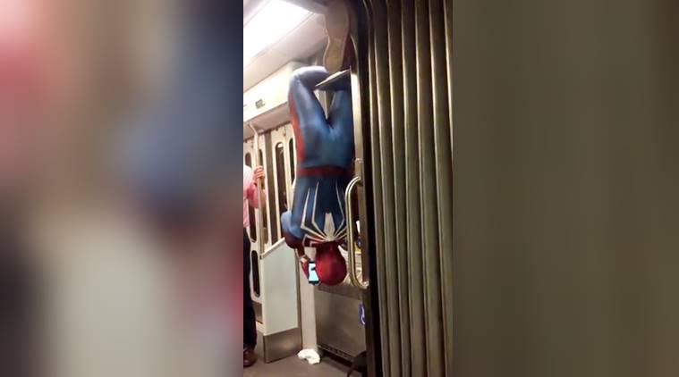 watch spider man hangs upside down on a train don t try this at