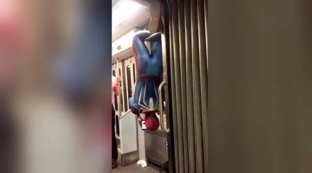 WATCH: Spider-Man hangs upside down on a train; don't try this at home (or, on the subway)!