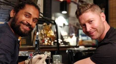 Michael Clarke gets inked, Vikas Malani inks Carpe Diem on Michael Clarke , cricket tattoos, tattoos, simple tattoos, indian express, indian express news
