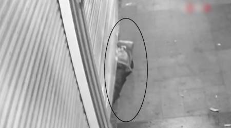 CCTV VIDEO: Thief wriggles into jewellery store through the narrow gap of the shutter