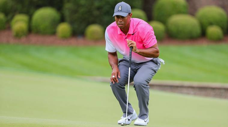Tiger Woods lines up his putt on seven during the third round of the Wells Fargo Championship golf tournament at Quail Hollow Club