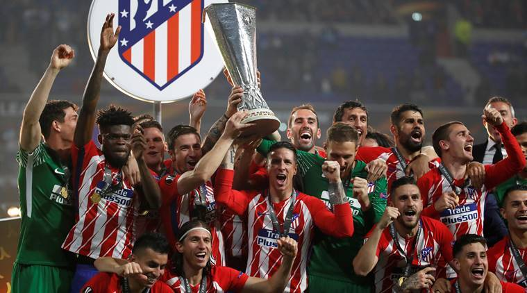 Atletico Madrid's Fernando Torres and team mates celebrate with the trophy after winning the Europa League