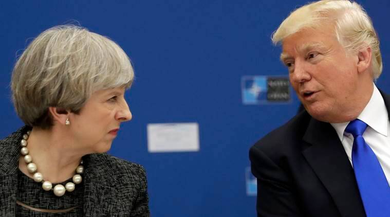 US President Donald Trump (right) speaks to British Prime Minister Theresa May during a working dinner meeting at the NATO headquarters. (AP/File)