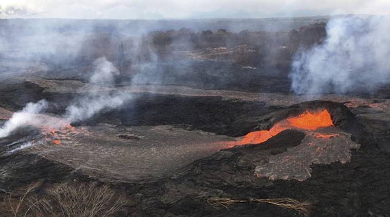 Volcanic ash swamps Hawaii school, turning tennis court gray