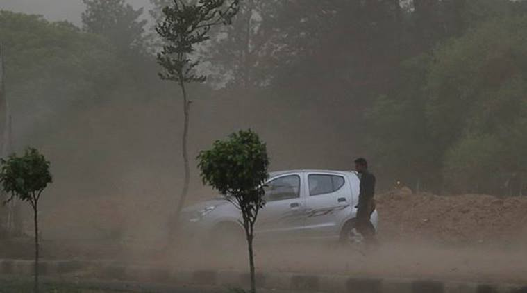 Dust storm accompanied by rain also hit Chandigarh and its surrounding areas in Punjab, Haryana and Himachal Pradesh, bringing down the temperature. (Express Photo by Sahil Walia)