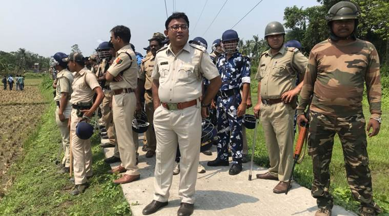 Police block the way to Ghazipur where booths have allegedly been captured. (Express photo by Shubham Dutta)