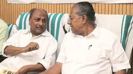 Kerala CM Pinarayi Vijayan with Congress leader A K Antony in New Delhi on Saturday. (Express photo/Amit Mehra)