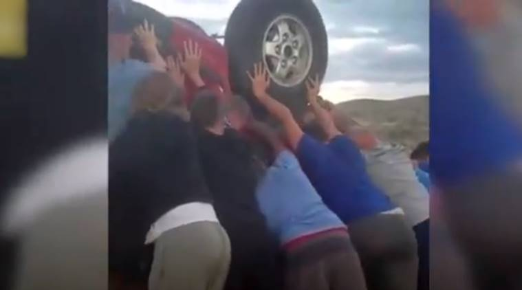 car crash video, teenagers save couple from car crash, football team saves couple, car crash rescue by teenage boys, viral video, indian express, indian express news