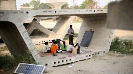 In sapping Delhi summer, a classroom comes alive on concrete flyoverslab