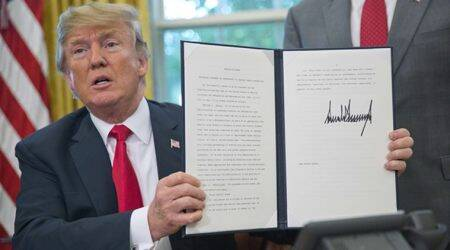 In reversal, Donald Trump signs executive order to keep families together at border