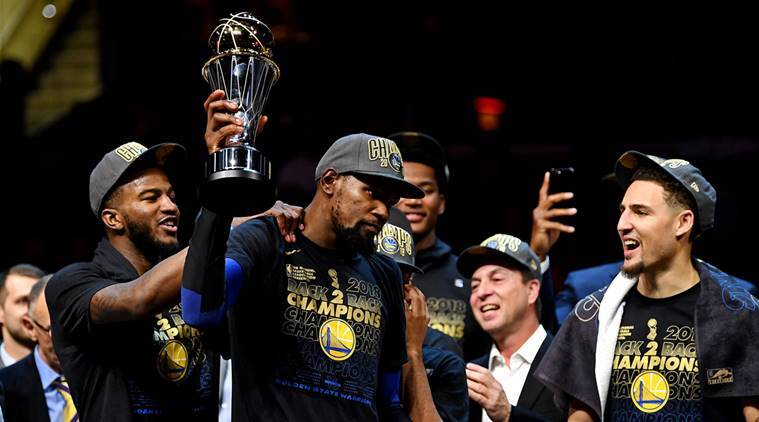 Golden State Warriors forward Kevin Durant (35) celebrates with the Bill Russell NBA Finals Most Valuable Player Award after beating the Cleveland Cavaliers in game four of the 2018 NBA Finals at Quicken Loans Arena.