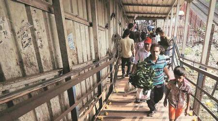 Mumbai: Officials keep eye on crowd on foot overbridge during rains