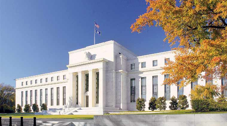 Fed raises key interest rate and sees possible acceleration in hikes