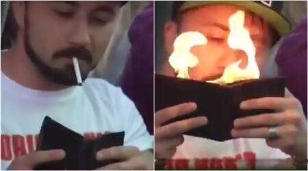 FIFA World Cup 2018: Just a JAW-DROPPING video of a man at Iran vs Spain match lighting cigarette using wallet