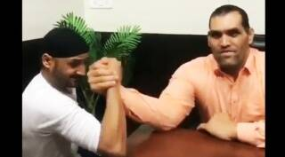 Harbhajan Singh or the Great Khali — Guess who must've won this arm-wrestlingmatch?