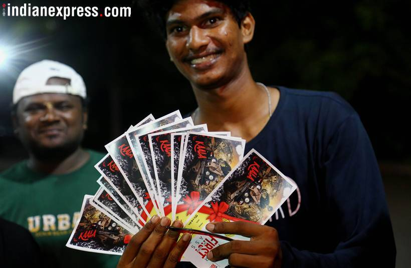 fans pose with tickets of kaala