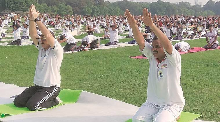 At a yoga session in Maidan, Kolkata, on Thursday. (Express photo/Partha Paul)