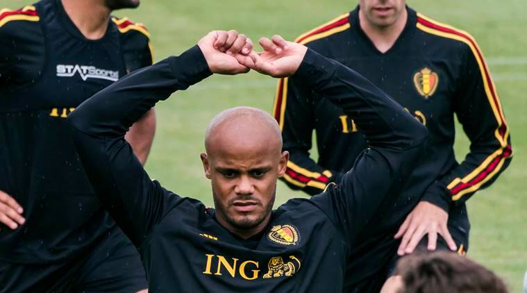 Belgium's Vincent Kompany warms up with other Belgian players during a training session at the Belgian Football Center in Tubize, Belgium