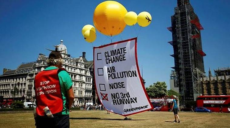 amid protests british parliament votes to expand london s heathrow