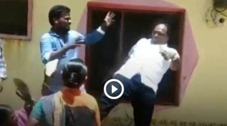 Watch: Telangana local body chief 'kicks' woman in chest over land dispute
