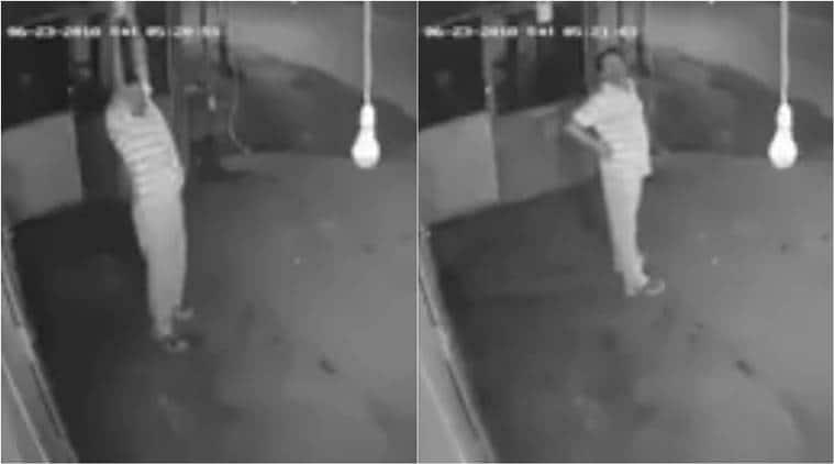 man steals bulb, man steals bulb exercise, man exercise bulb theft, bulb theft video, bulb theft viral video, indian express, indian express news