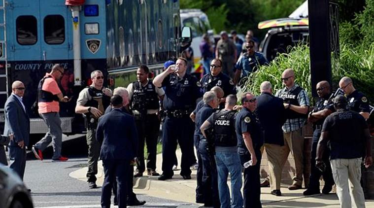 Police walk near the shooting scene after the gunman opened fire at the Capital Gazette newspaper in Annapolis, Maryland, on Thursday. (Reuters)