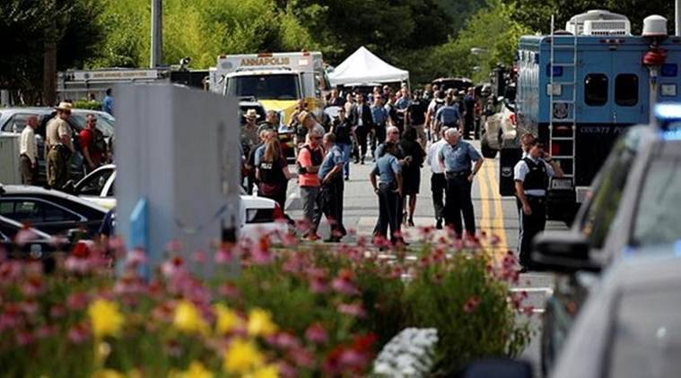 Maryland newspaper shooting suspect barricaded the exit doors