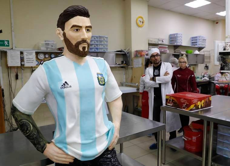 Bakers of Altufyevo Confectionery prepare a life-size chocolate sculpture of Argentine soccer player Lionel Messi to top a cake for the celebration of his upcoming birthday in Moscow