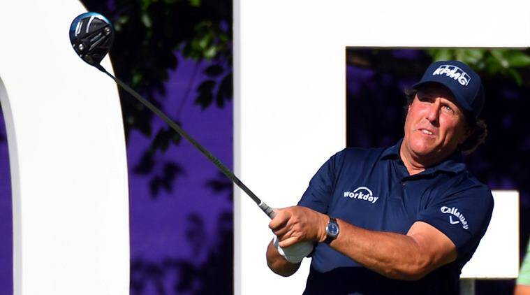 Phil Mickelson hits his tee shot on the 13th hole during the first round of the FedEx St. Jude Classic golf tournament at TPC Southwind in Memphis, Tenessee