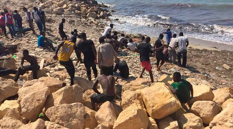 At least 100 feared dead after boat sinks off Libya coast