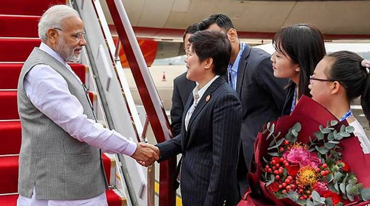 Prime Minister Narendra Modi being welcomed on his arrival at Qingdao, China on Saturday. (PTI)