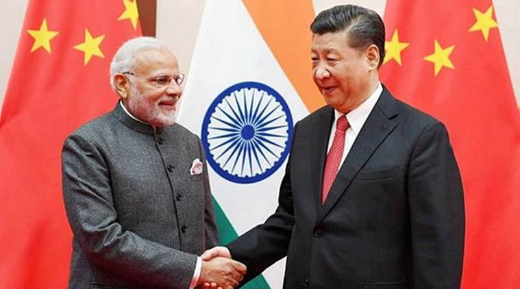 Prime Minister Narendra Modi with Chinese President Xi Jinping in Qingdao in China on Saturday. (Reuters)