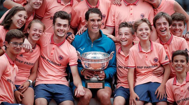 Rafael Nadal celebrates after lifting the French Open title
