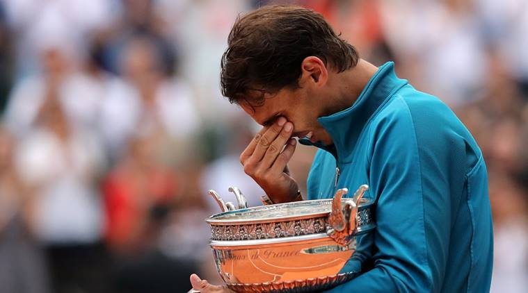 Spain's Rafael Nadal celebrates with the trophy after winning the French Open final against Austria's Dominic Thiem