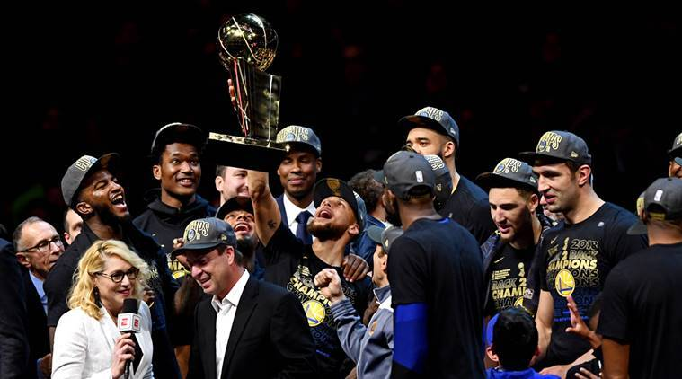 Golden State Warriors guard Stephen Curry (30) celebrates with the Larry O'Brien Championship Trophy after beating the Cleveland Cavaliers in game four of the 2018 NBA Finals at Quicken Loans Arena.