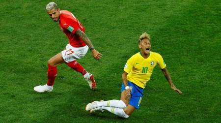 Switzerland's Valon Behrami in action with Brazil's Neymar